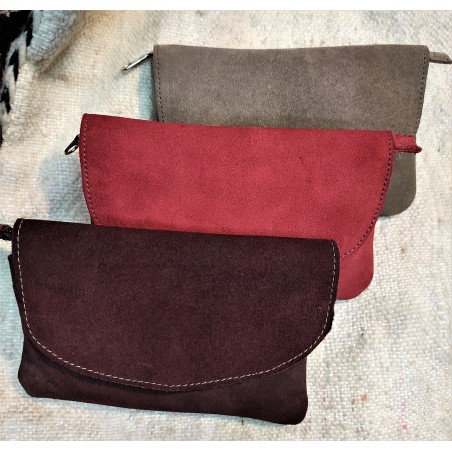 zipped and flapped suede pouch